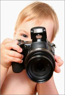 bebé con cámara